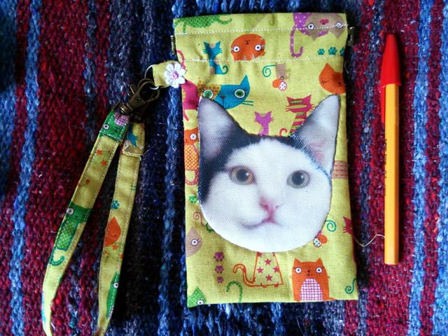 セイラお顔 バネ口スマホケース(18×11)¥1300
